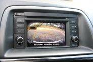 Egy képernyő sok funkcióval: precíz a Tom-Tom navigáció, jól szól a Bose hifi, a tolatókamera hasznos lehet